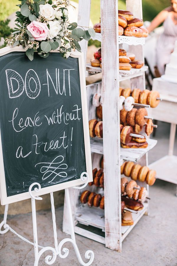 Caitlin and Matt's Garden California Wedding by Kambria Fischer Photography | Clever and cute, the couple served desserts with a DIY donut wall at their outdoor wedding reception.