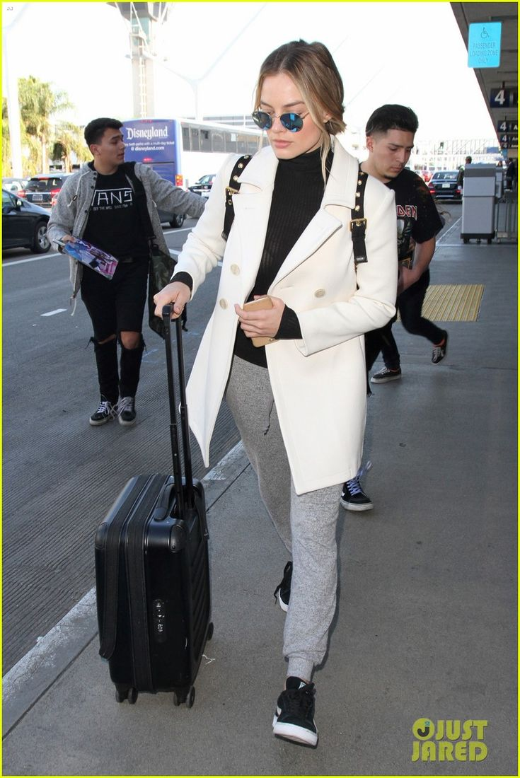 Margot Robbie Stylishly Arrives Back in LA