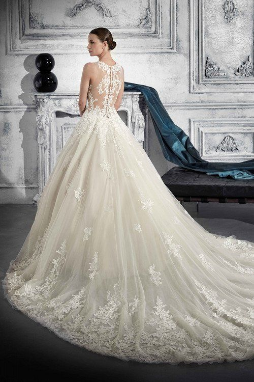 73cc4345a1aa9 Romantic, A-line wedding dress with lace, illusion back and train. Style  769 by Demetrios.