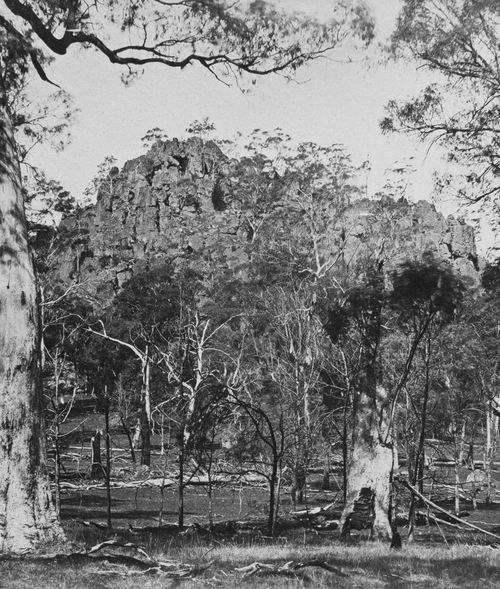 Hanging Rock, Australia, photo by Richard Daintree in 1858.  Location of the haunting, mysterious novel & film Picnic at Hanging Rock. During the shooting of Peter Weir's film several clocks and watches did actually stop working just like in the story; nearby there is a road called Straws Lane, where cars will roll uphill; and in recent times on the Rock itself a girl got lost and was later found pacing in circles round a stone called the Saddle, scared and bewildered.