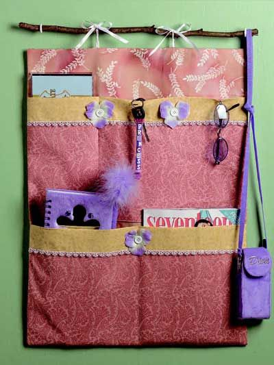 """Give your teenage daughter another tool to help organize her room. This free sewing pattern makes a stylish wall hanging with pockets to hold her possessions. Finished wall hanging is 18"""" x 24""""."""