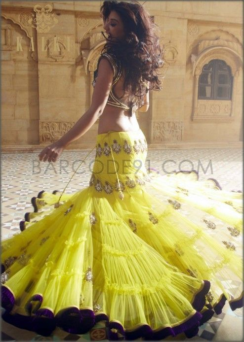 Yellow lehenga with antique embroidery by Kalki, 1369 USD