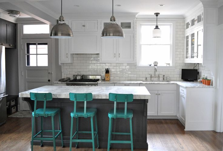Check Out 23 Inspiring Eclectic Kitchen Design Ideas. The eclectic kitchen includes merging of various styles, for instance adding contemporary kitchen island and mis-matching it with exposed wood beams.