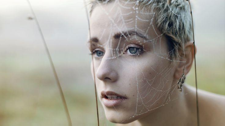 Self-portrait through a spiderweb