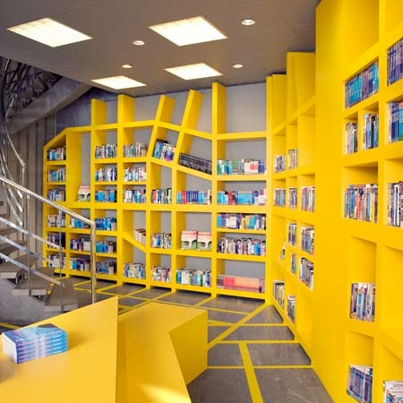 Unique Whimsical Bookcase Design At The Vagabond Travel Bookshop By Smansk  Design Studio.