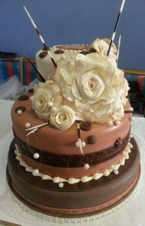 African 3tier wedding cake with gumpaste roses