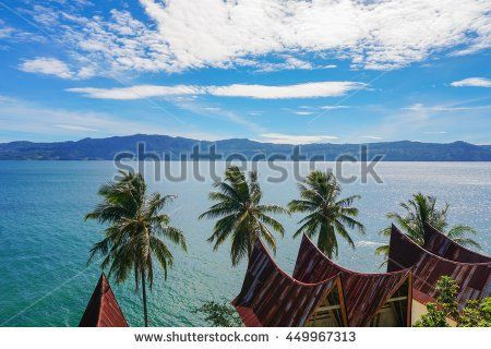 View of Toba lake with traditional batak-style roofs from Samosir island, North…