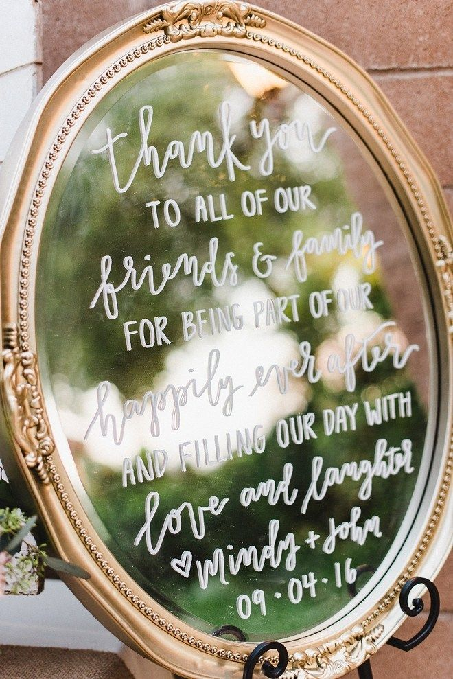 These handwritten mirrors made the perfect glam and elegant signage at this stunning vineyard wedding!
