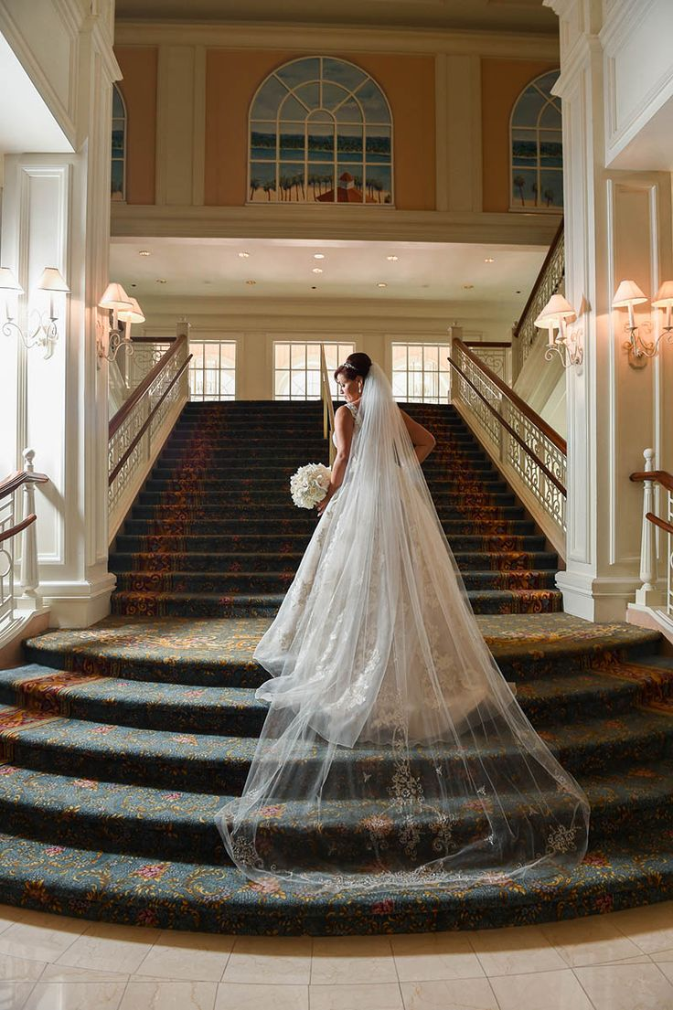 A bride showing off her gorgeous wedding gown at Disney's Grand Floridian Resort & Spa.