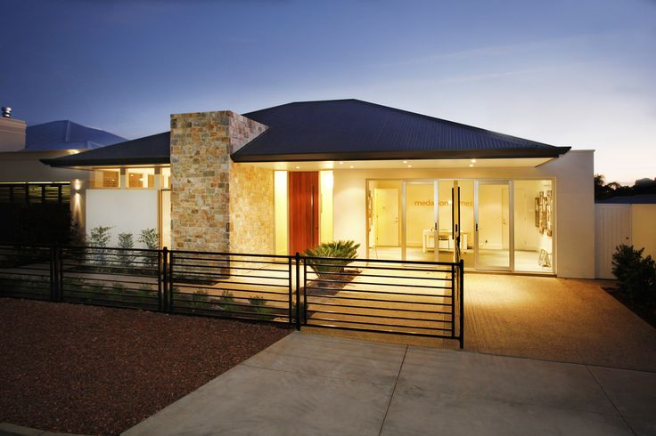 A stone feature pier and dark coloured roof give this home dramatic street appeal...
