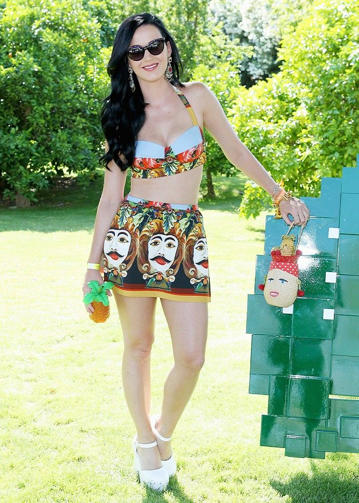 Katy Perry looks festival ready in this Dolce & Gabbana Moon Print Mini Skirt and white platforms