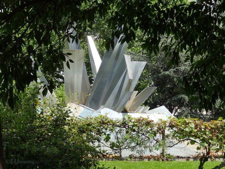This photo we took while under some trees in the shade shows the metal fountain which decorates the Bela Bartok square in Paris, which is surrounded by trees and greenery to make a calming place to relax.  See more Paris Photos at www.eutouring.com
