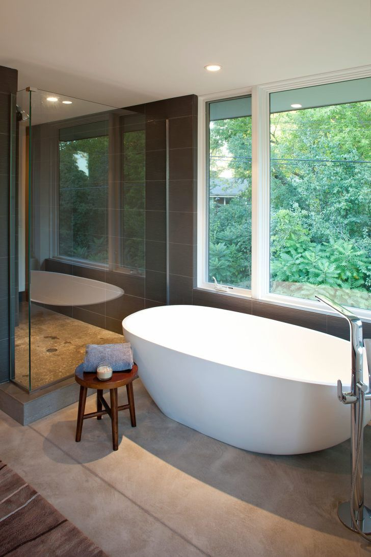 White Acrylic Freestanding Tub And Rounded Brown Wooden Stool Also Glass  Shower Room And