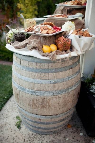 awesome way to set up appetizers!  large tray on top of barrel, height in the middle & smaller tray on top