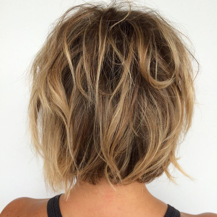 brown messy bob with blonde and caramel highlights