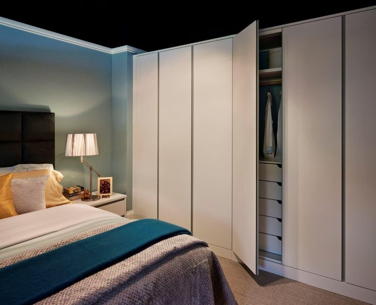Minimalist styling - Pure bedside cabinet and fitted wardrobes from John Lewis of Hungerford  http://www.john-lewis.co.uk/bedrooms/contemporary-pure-bedroom