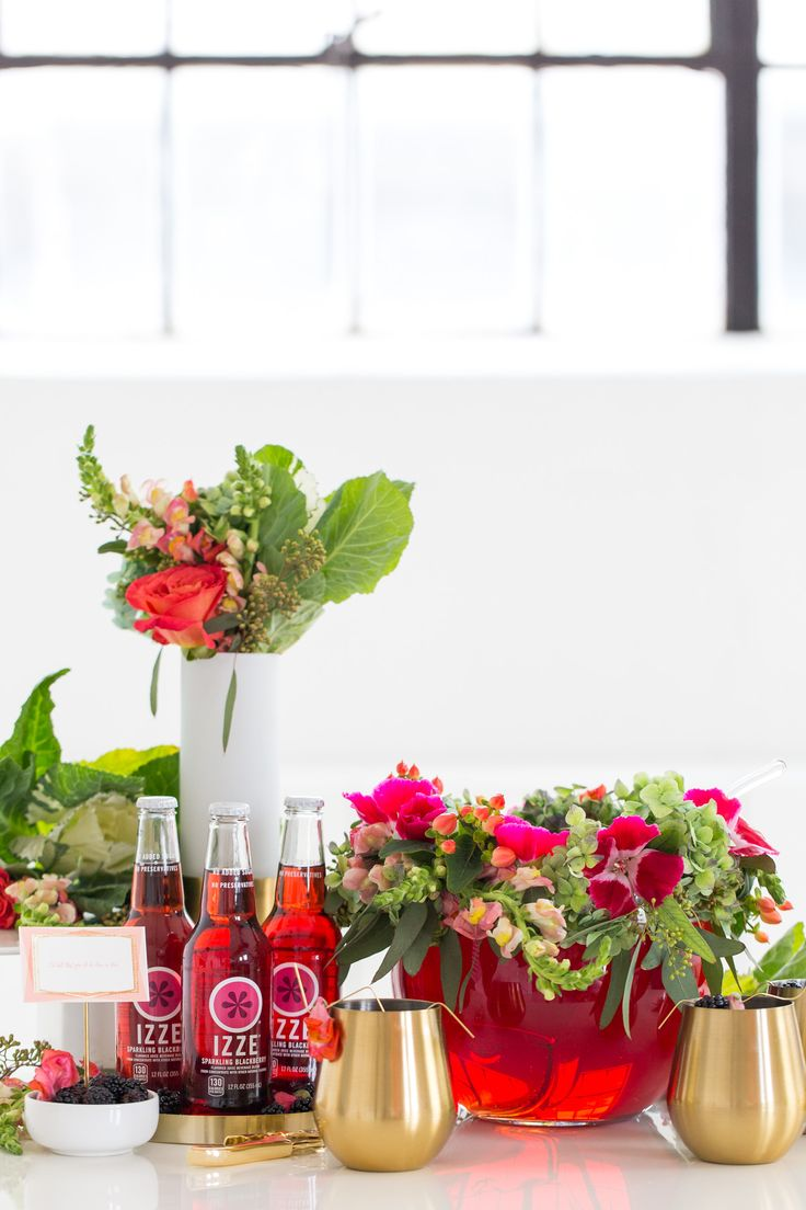 We're taking the floral garland straight to the punch bowl with this tutorial for a DIY Floral Punch Bowl Wreath and recipe!