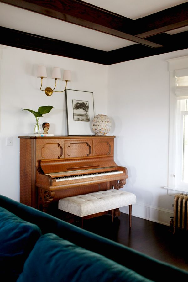 custom piano bench and styling by the emerald studio | via coco+kelley