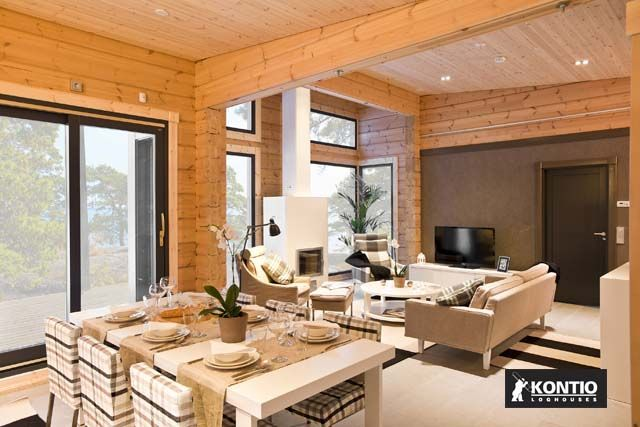 Cheminée dans la maison en bois Kontio.  http://www.kontio.fr/