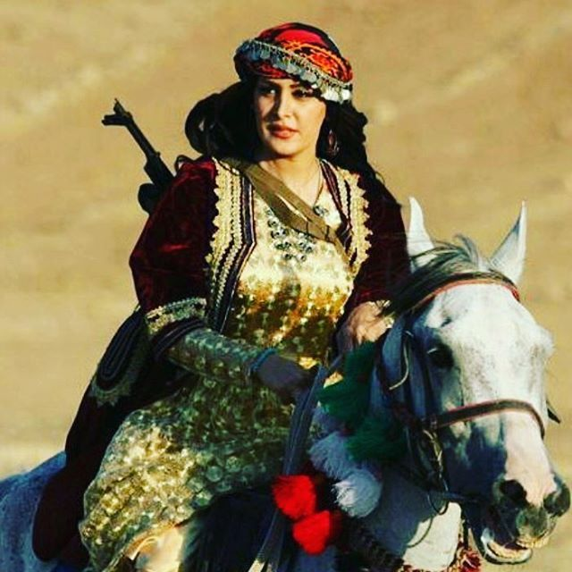 "Armed Woman from the Kurdish Kalhor Tribe. The Kalhor Tribe were an important tribe in Safavid times. Ely Soans and Hyacinth Louis Rabino described the Tribe as the most powerful tribe in the province of Kermānšāh, and Henry Rawlinson as ""one of the most ancient, if not the most ancient, of the tribes of Kurdistan""."