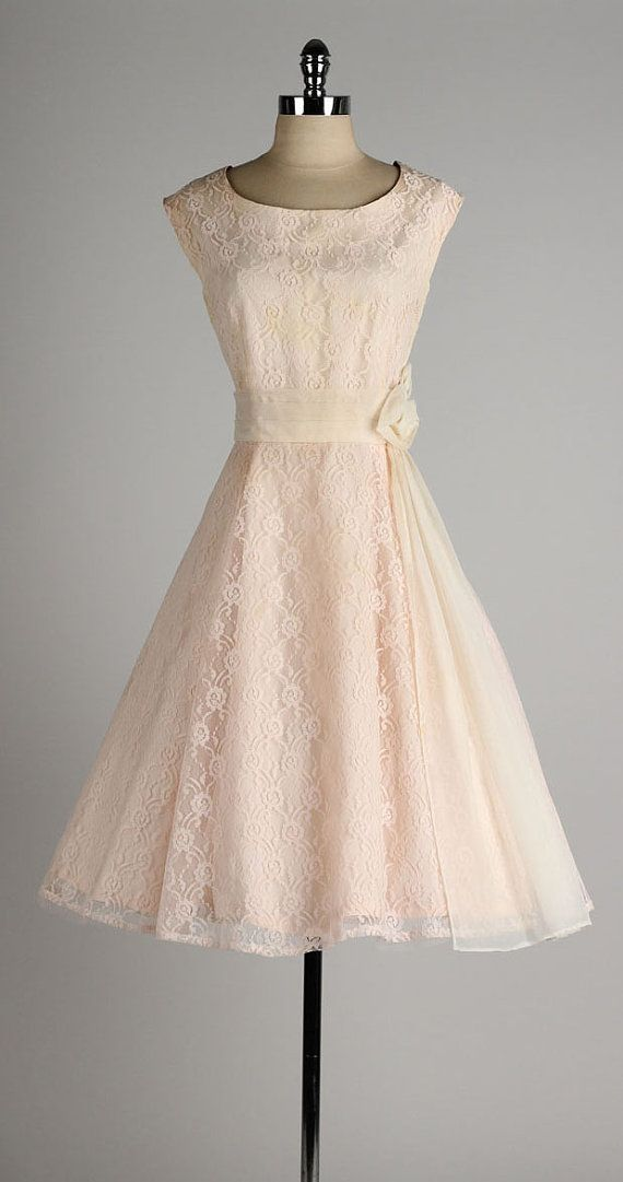 vintage 1950s blush lace and chiffon dress...love the touch of elegance that the sash and rose at the waist give it.