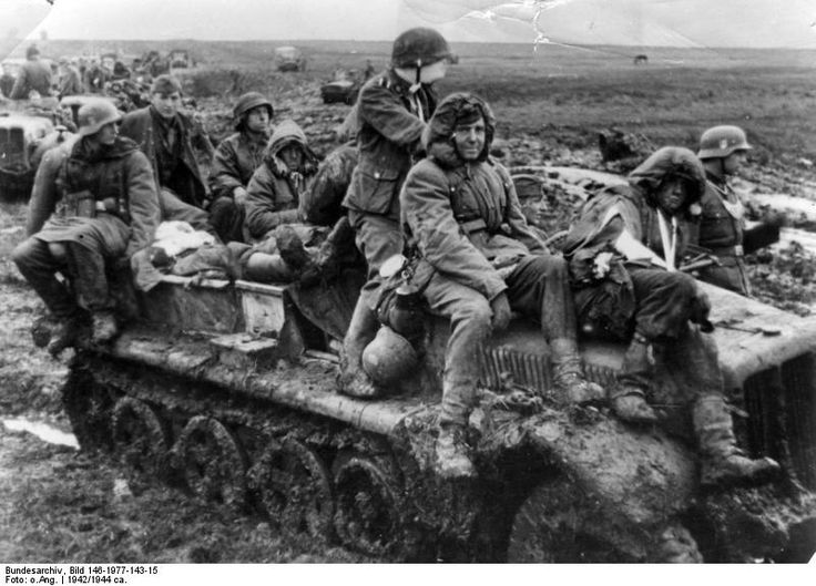 Russian mud, along with the Russian winter, was the worst enemy of the invading Germans during WW2. Here, grenadiers of the SS Totenkompf Division seek relief from struggling in knee-deep sludge aboard a half tracked vehicle, 1944.