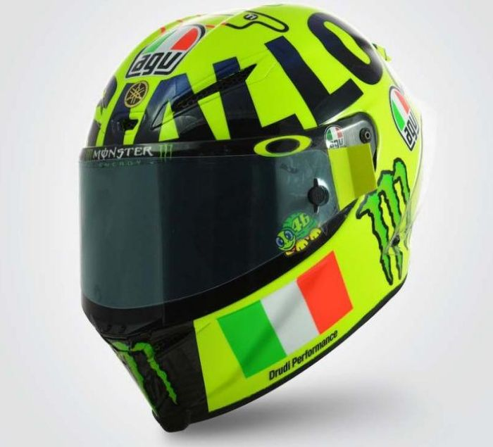 """Valentino Rossi 2016 Mugello helmet: Valentino Rossi's 2016 Mugello helmet was designed as a tribute to the fans the """"Popolo Giallo"""" (the Yellow crowd) and the circuit itself.  This bright yellow helmet combined Mugello with the Italian for yellow ('giallo') to create 'Mugiallo'. http://rossihelmets.com/valentino-rossi-mugiallo-helmet-mugello-2016/"""