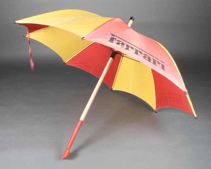Lot 171A vintage Ferrari wooden shafted and fabric umbrella sold for £30