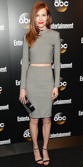 DARBY STANCHFIELD Also at the Entertainment Weekly and ABC celebration in N.Y.C., the flame-haired Scandal actress gives Gladiators something to talk, accessorizing her silver crop top and matching body-con skirt with a bold crimson lip color.