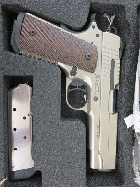 Used Sig Sauer 1911 Compact Nickel w/ night sights, extra magazine and case $895 - http://www.gungrove.com/used-sig-sauer-1911-compact-nickel-w-night-sights-extra-magazine-and-case-895/