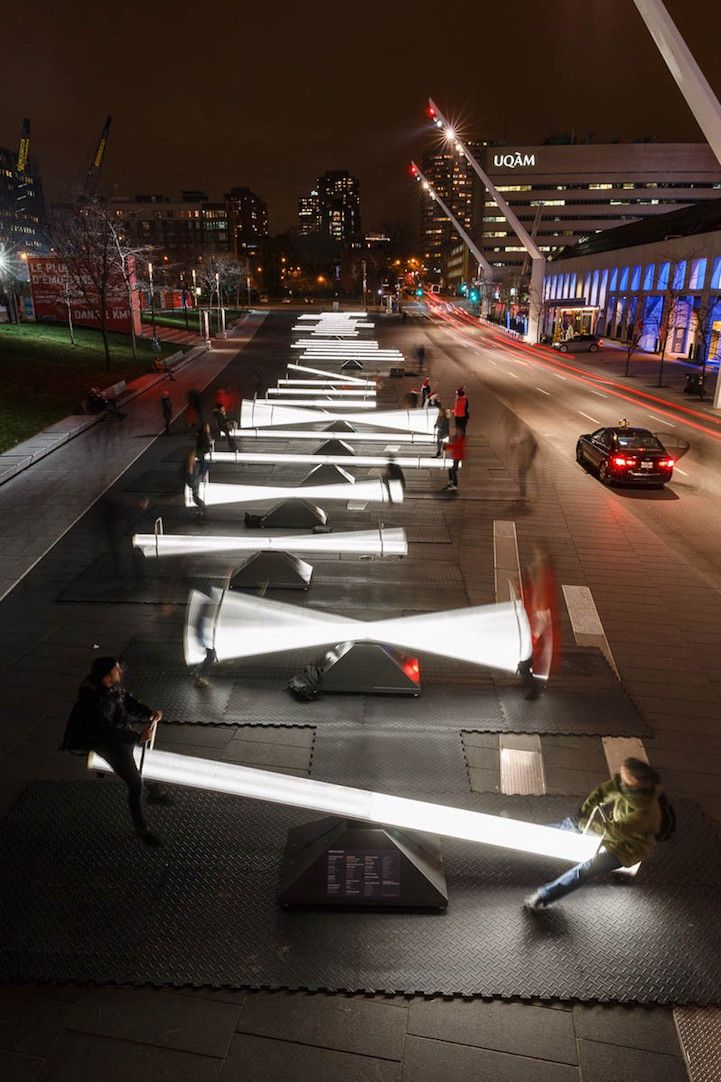 Designers and engineers collaborated to produce 30 interactive seesaws in Canada that fill the streets with radiant light and sweet sounds as people play on them. #installation #montreal