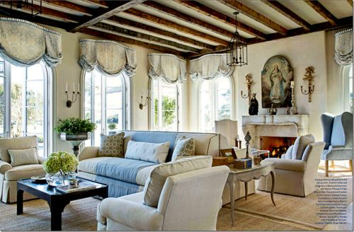 I love the sofas back to back that turn the large space into several cozy conversation areas. The ceiling is great too!
