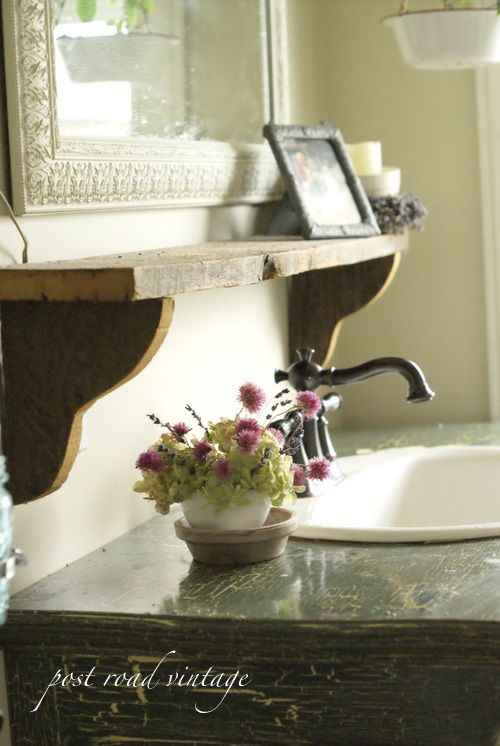 Great bathroom idea for all of those decorations that don't fit on the counter!