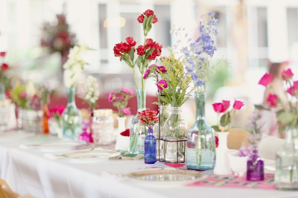 Colorful-Wildflower-Wedding-Reception-Centerpiece: Recycled Glasses, Wildflowers, Tables Sets, Wedding Ideas, Wedding Decor, Centerpieces, Long Tables, Jars, Wild Flowers