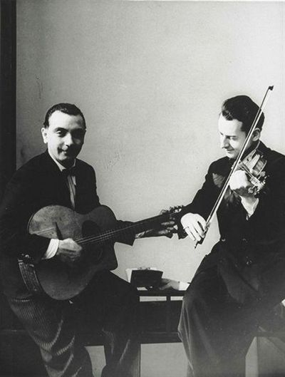 Hot Jazz du France: Django Reinhardt and Stephane Grapelli,1935  by Erwin Blumenfeld.  Django and Stephane were the nucleus of Quintette du Hot Club de France and single-handedly established European jazz.  Virtuoso guitarist Reinhardt has influenced nearly every jazz guitarist since the early '30s, and others like Willie Nelson.