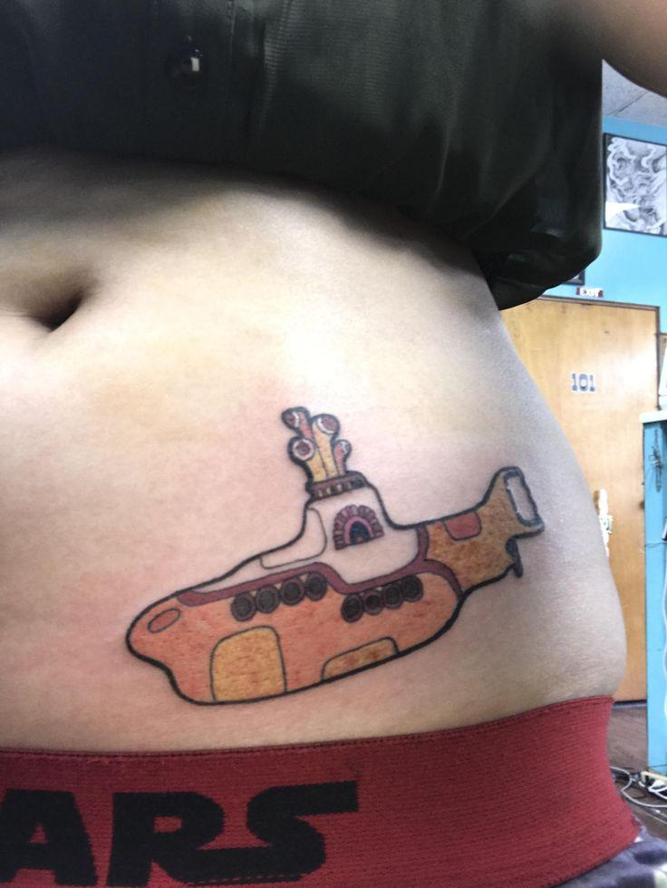 Yellow submarine by brent (?) native flesh tattoo hilo hawaii