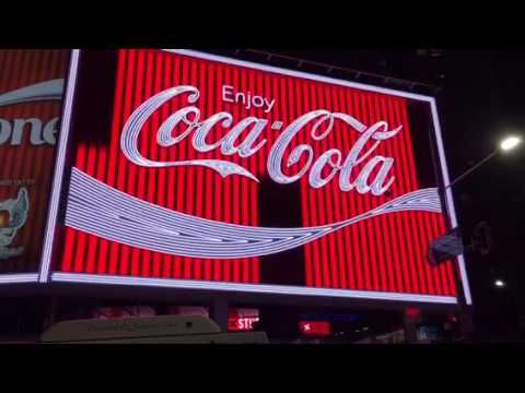 Coca Cola Sign lights up in Kings Cross on 15 Sept 2016