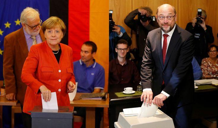 Angela Merkel, chanceler da Alemanha e candidata à reeleição pela União Democrata-Cristã (CDU), e Martin Schulz, líder do Partido Social-Democrata (SPD), Angela Merkel, votam neste domingo (24). (Foto: Kai Pfaffenbach/Francois Lenoir/Reuters)
