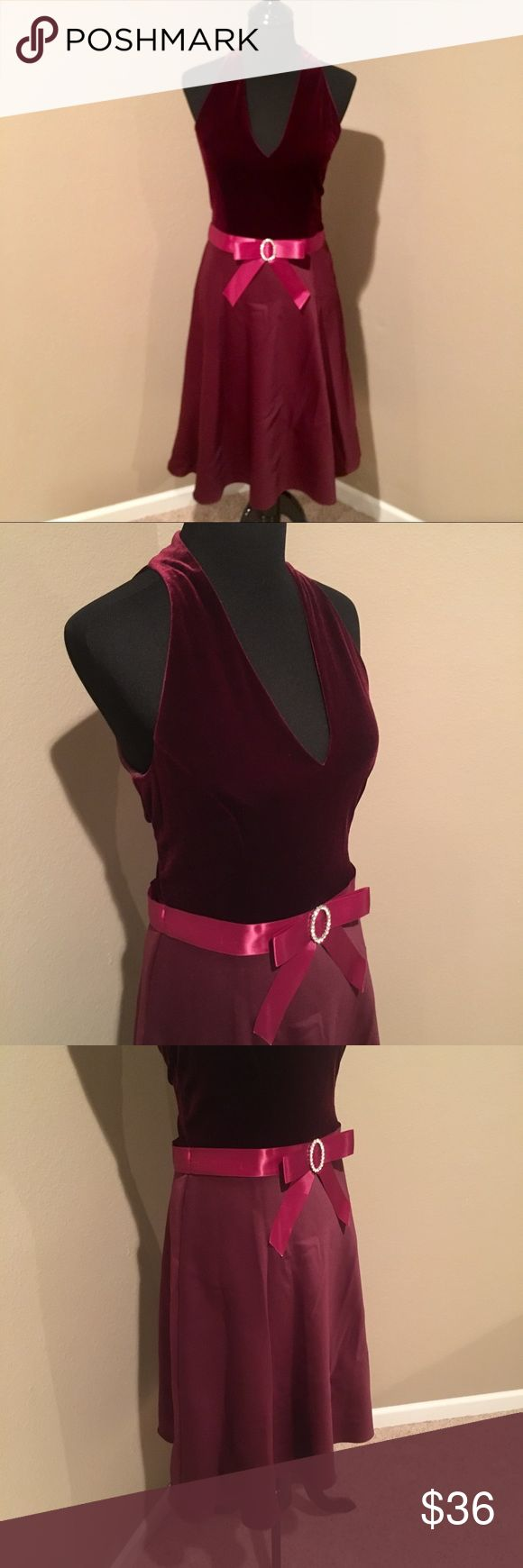"""❤️Jessica Howard burgundy party dress Jessica Howard burgundy party dress. Sleeveless v-neck velvet top with zip up back and two buttons at neck.  Skirt with full lining & netting to give just the perfect amount of swing!  Ribbon & bow around waist w/ crystal accents. So flattering!!  One tiny spot noted as shown - on back next to zipper. Also a couple of small imperfections on ribbon as shown - not very noticeable.   This would be perfect for Valentine's Day ❤️❤️!!   Bust - 17.5"""" Waist…"""