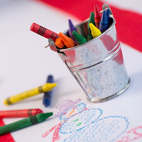DIY Christmas Kid's Tablecover White flat Paper $18.99 per roll Metal Buckets $9.99 per dozen Crayons $1.99 set of 8 boxes Red Steamer $.75 per 81' roll