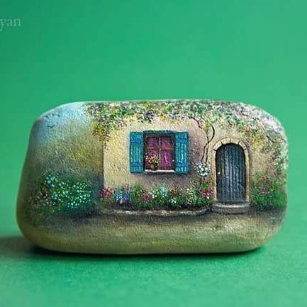 House with Aqua door& window painted on a rock.