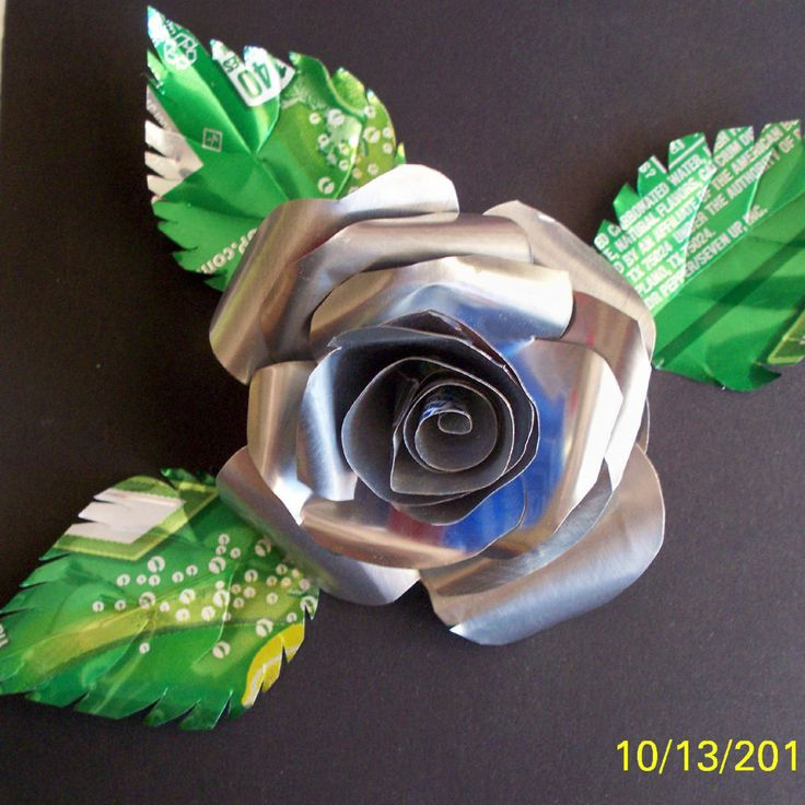 While looking through some ibles the other day, I came across this: https://www.instructables.com/id/Drink-Can-Butterflies/ So, liking quick and easy projects, I proceeded to make a few....the wheels are always turning, and it wasn't long before I thought, hey I could make my roses out of this stuff! So an Idea was born, in my mind, at least, and this instructable is about the process I went through to make a few roses. In the two flower photos, the only rose of metal is the one in the green…