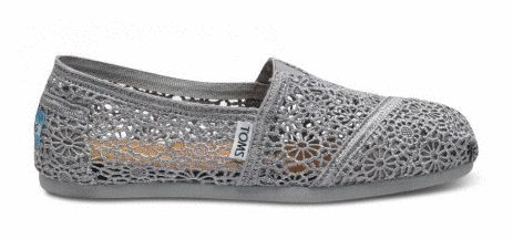 Crochet TOMS shoes are back on sale. This season they've got silver.