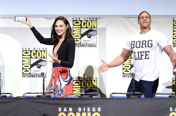 Actors Gal Gadot, taking a selfie, and Ray Fisher attend the Warner Bros. 'Justice League' Presentation during Comic-Con International 2016 at San Diego Convention Center on July 23, 2016 in San Diego, California.