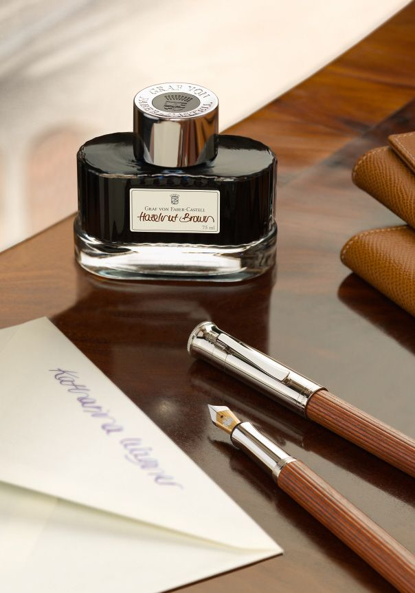 With its glossy screw top, embellished with the Graf von Faber-Castell coat of arms and lettering, the ink bottle is an exceptional eye-catcher on the desk and the perfect addition to the ensemble of excellently finished writing instruments and accessories. Available in red, blue, green, brown, black and grey. #ink #fountainpen #brown #hazelnut #inkbottle #grafvonfabercastell