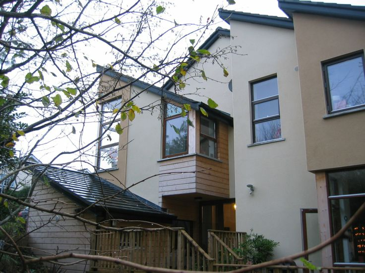 This is a timber-framed house in Bray, Co. Wicklow. Designed on a difficult sloping site and yet is fully compliant with access-for-disabled requirements.
