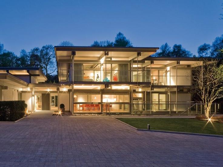 Huf haus art sonder mit flachdach huf haus bei nacht for Haus modern flachdach