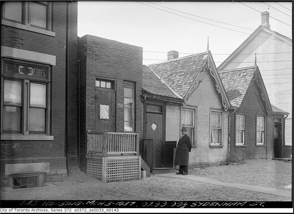 Smallest house in Toronto (1930s) Click the image and fade the picture out to see what it looks like today.