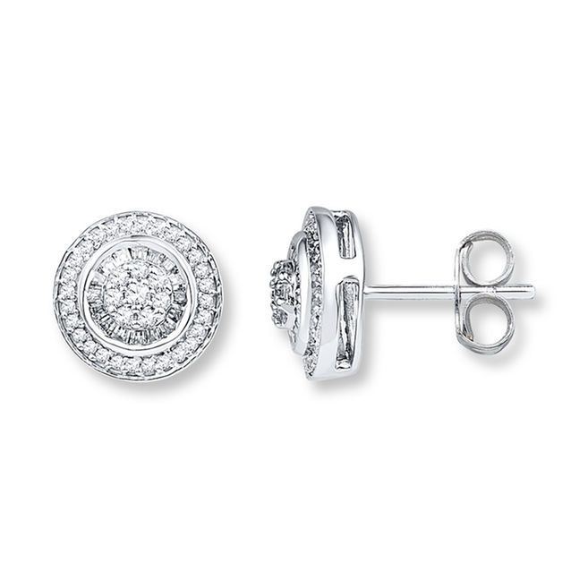 Baguette diamonds frame a cluster of round diamonds in the center of each of these stunning earrings for her. Additional round diamonds encircle the center to complete the look. Fashioned in 10K white gold, the earrings have a total diamond weight of 1/2 carat, and are secured with friction backs. Diamond Total Carat Weight may range from .45 - .57 carats.