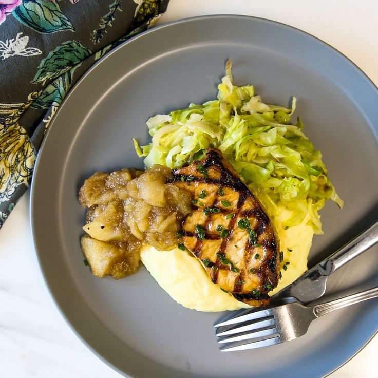 Apple Glazed Pork Loin. A brined, grilled, antibiotic-free boneless pork chop presides over this satisfyingly complete meal. We pair this centerpiece with not one but two sides that expertly complement pork—butter braised savoy cabbage and mashed potatoes. An apple cider glaze and a side of spiced apple sauce bring fruity balance to the rich, comfortable flavors of these sides. The result is a full plate packed with diverse flavors and enticing simplicity.
